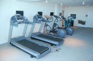 Gym equipment at Beau View vacation condo rentals in Biloxi.
