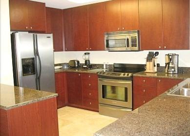 Kitchens with granite and stainless appliances in Sea Breeze condo rentals