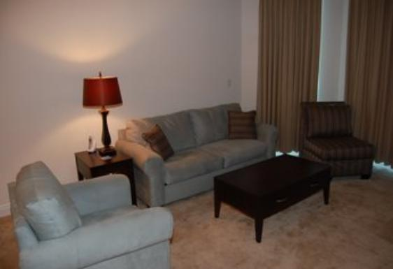 Living room with balcony access. Beau View condo rental, Biloxi