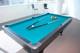 Game room with pool table.  Beau View condo rentals in Biloxi