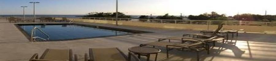 Photo of pool overlooking Biloxi beach from Ocean Club condo